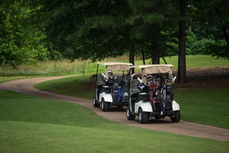 Golf carts on the trail at the golf course in Traditions of Braselton
